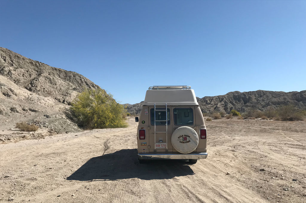 Generic-Van-Life-Camping-Spot – Box Canyon – California -United-States-back view of the van