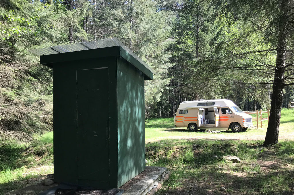 Generic-Van-Life-Camping-Spot-Spruston Staging Area- Vancouver Island – British Columbia – outhouse – vault toilet view
